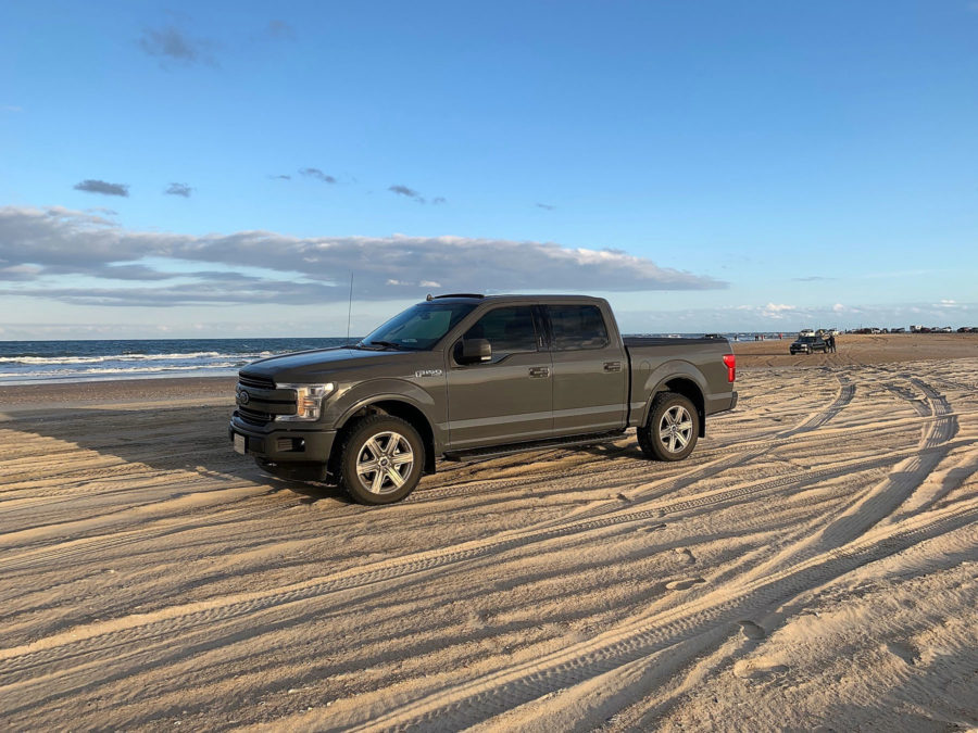Truck driving on the beach Outer Banks, North Carolina