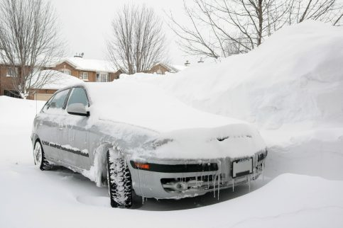 Car Parked in Snowy Driveway
