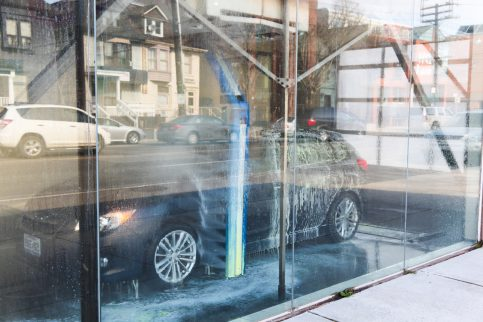 """Toronto, Canada - March 15, 2012:A car in an automatic touchless carwash on the side of road at Dupont Street in downtown Toronto."""