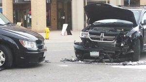 two destroyed vehicles accident in a crash in the middle of the street