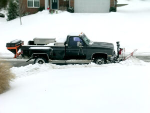 Straight Plow on a Truck Clearing the Street